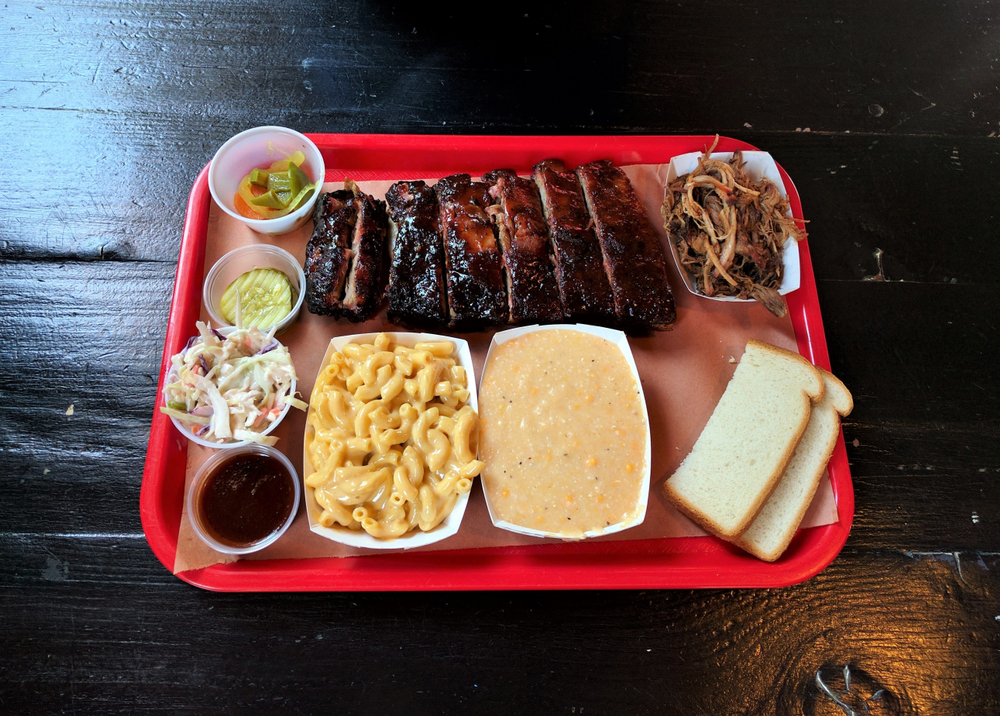 tray of the best BBQ in nashville with delicious food options on it