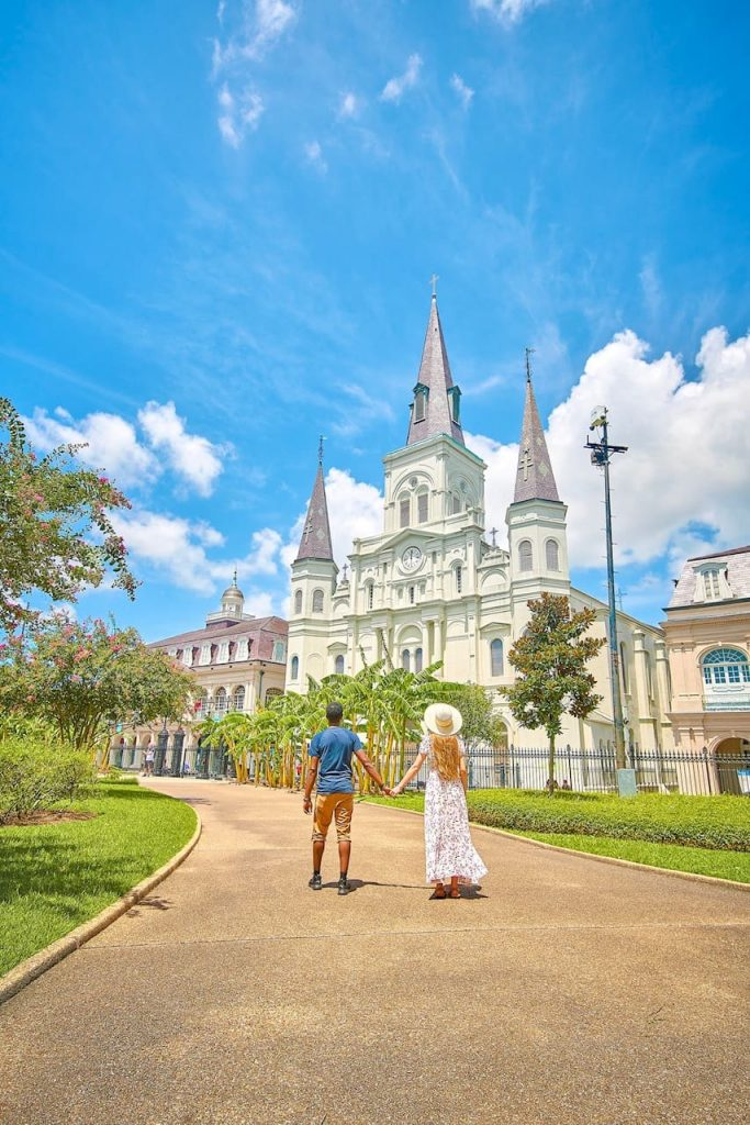 Terrence and Victoria walk hand in hand through downtown New Orleans