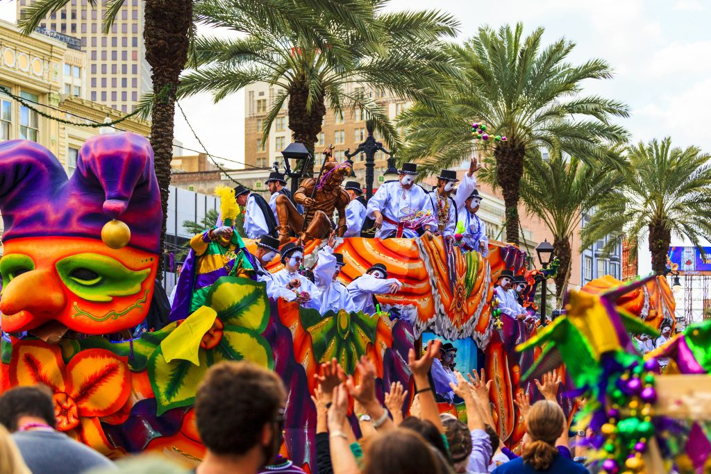 A parade during Mardi Gras, the best time to visit New Orleans