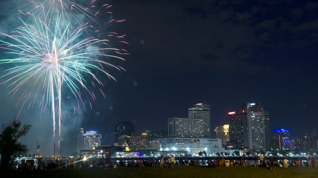 Fireworks illuminate the New Orleans skyline for July 4th, the best time to visit New Orleans