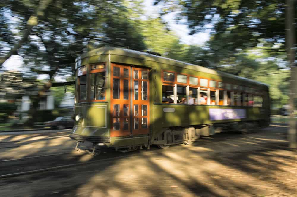 A streetcar in New Orleans zooms by.