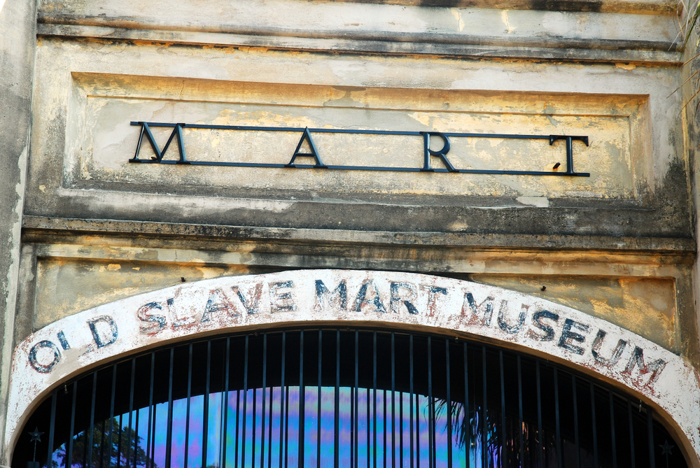 The entrance of the Old Slave Mart Museum. It is stone, with words painted on it that are fading. A great way to learn about a weekend in Charleston