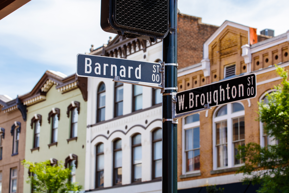 A road sign showing the intersections between Broughton Street and Barnard Street in an article about shopping in Savannah