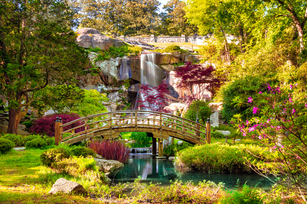 A beautiful scene of the garden and waterfall in Maymont, one of the best things to do in Virginia.
