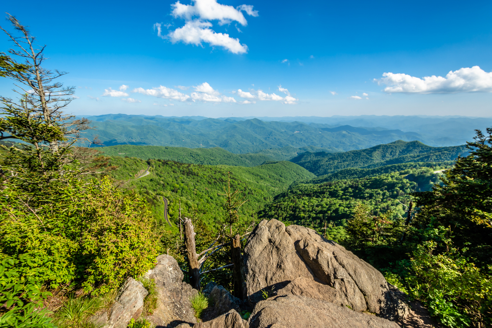 A serene photo at the Waterrock Knob Overlook providing a beautiful view of the mountains that can be seen as far as the horizon.