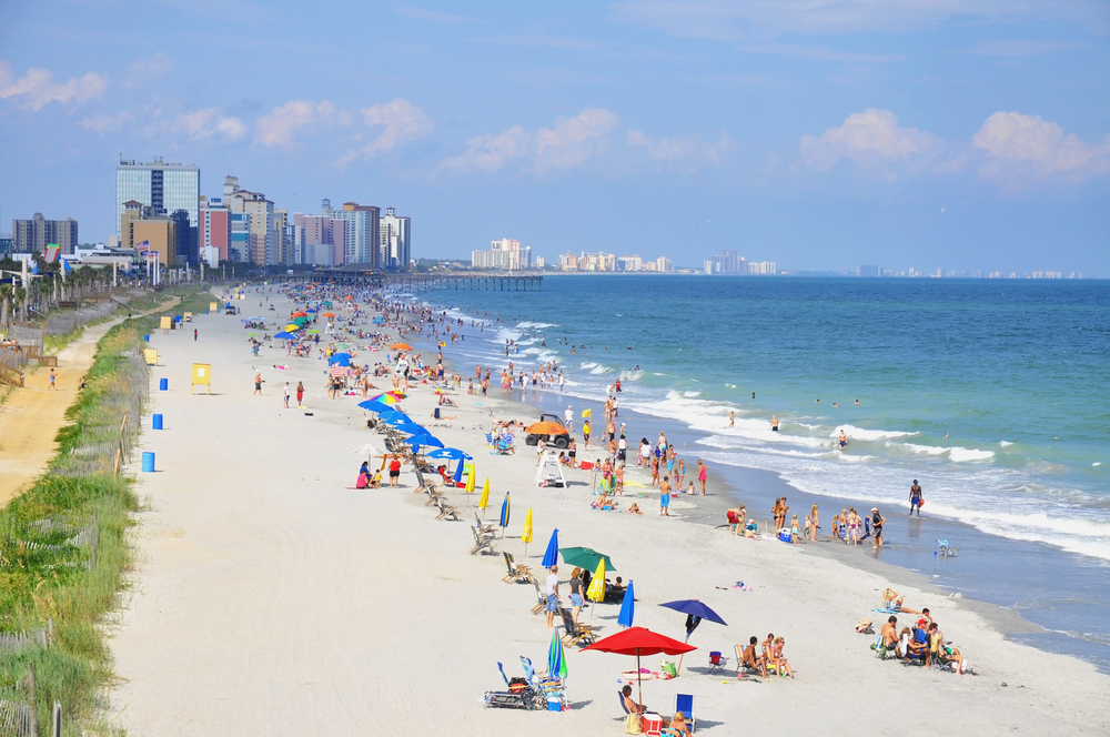 beach chairs and people on Myrtle Beach in South Carolina
