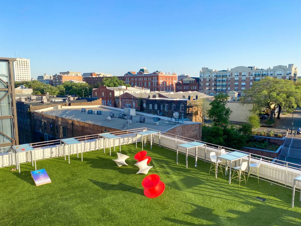 Giant toys sit on the lawn at the Electric Moon Rooftop Bar at the Plant Riverside District.