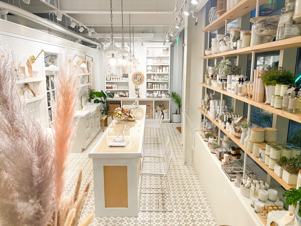Shelves are lined with plants and vases at Urban Poppy.