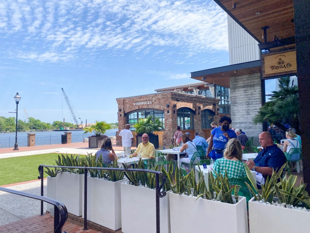 Guests enjoy food and drinks on the patio of the Savannah Tequila Company lawn.