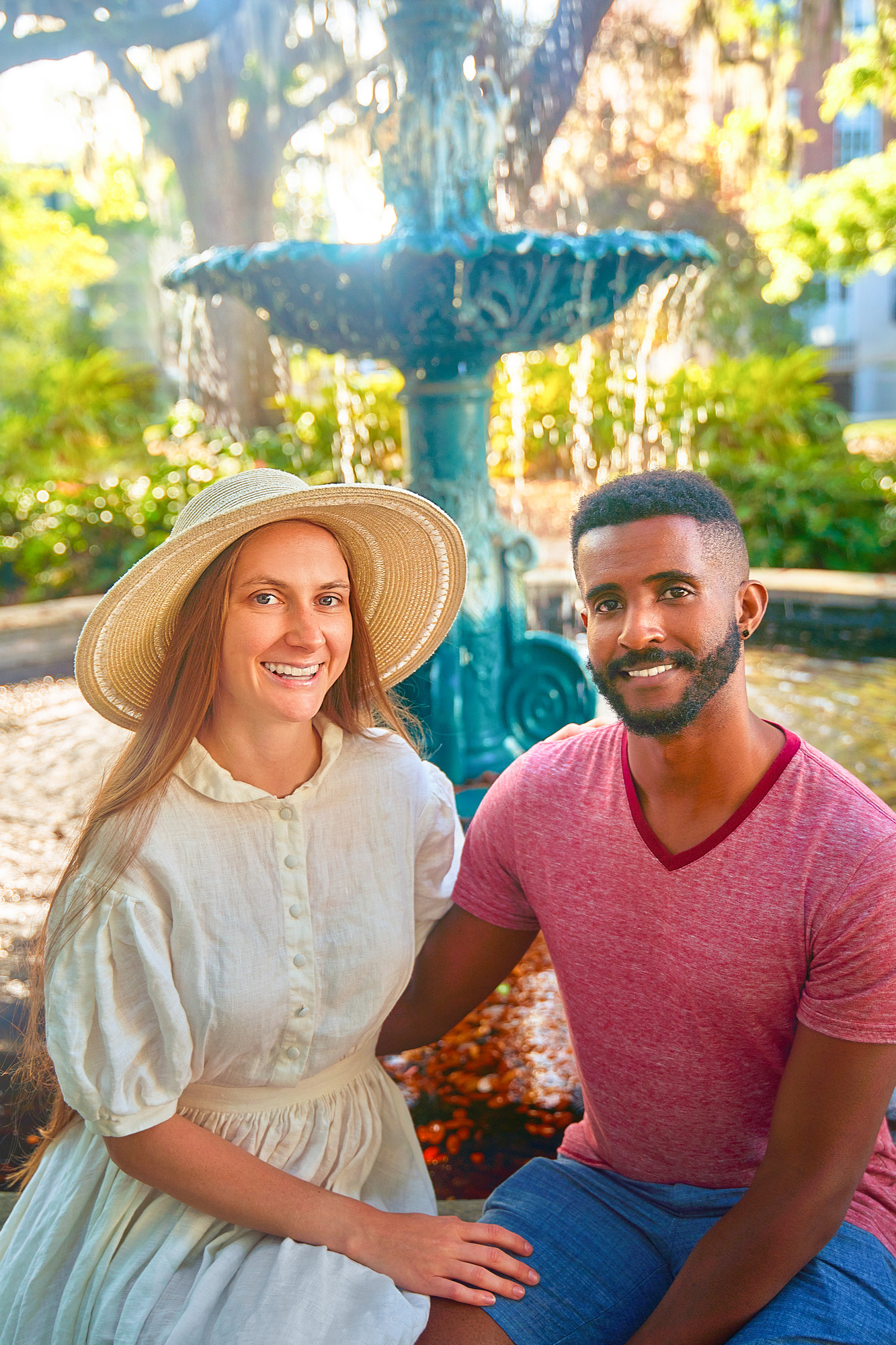 Victoria Yore and Terrence Drysdale sitting in front of a fountain in Savannah Georgia for Southern Trippers About Me photo