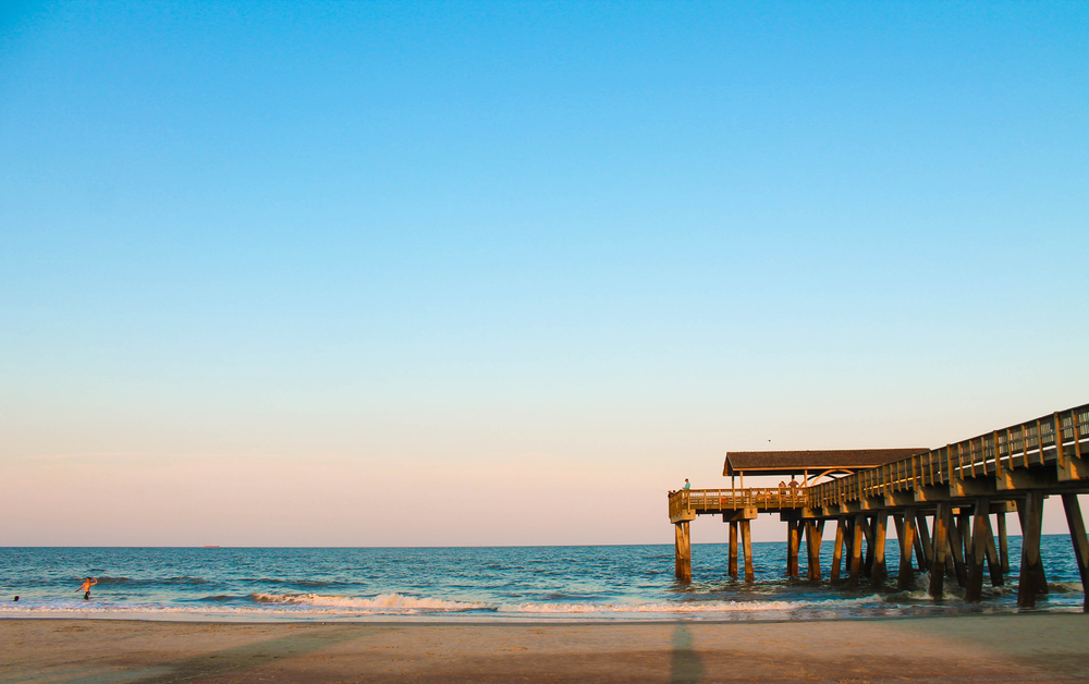 beach and fishing pier over water