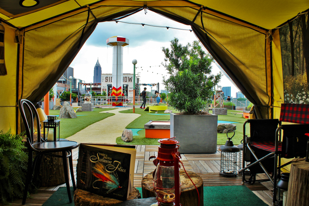 On the Rooftop of Ponce City Market you will find cozy restaurants space with yard games and a pathway