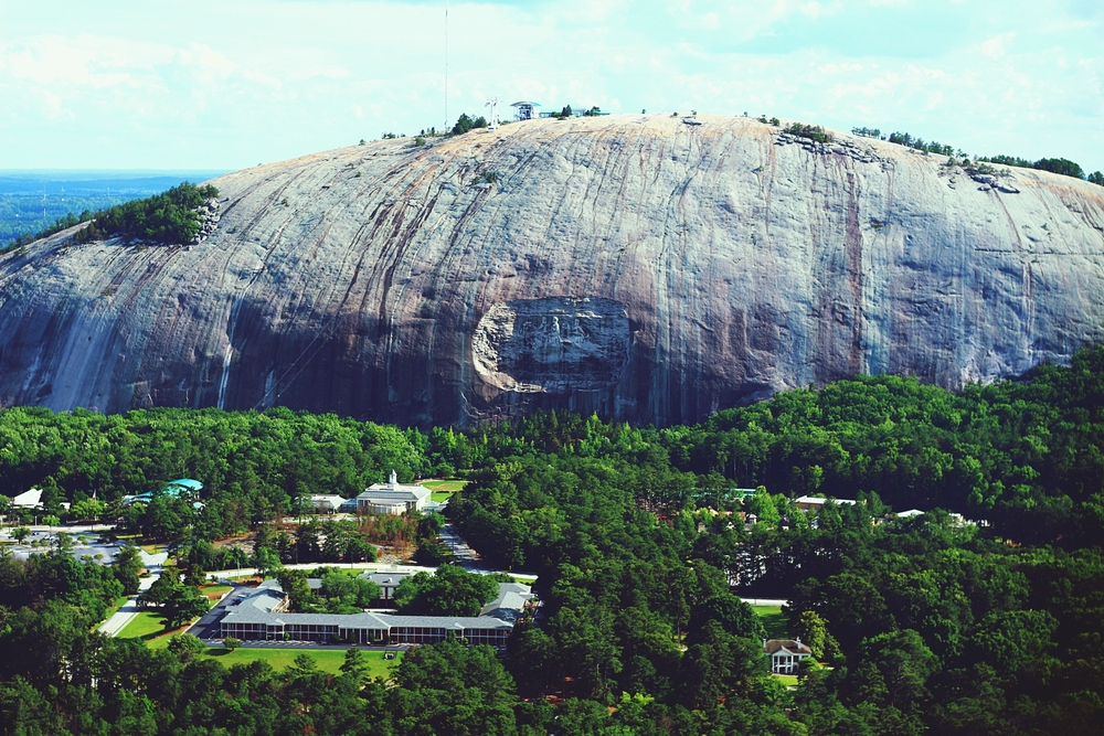 Stone Mountain is a large granite faced mountain where you can see carving of figures coming out of the trees below
