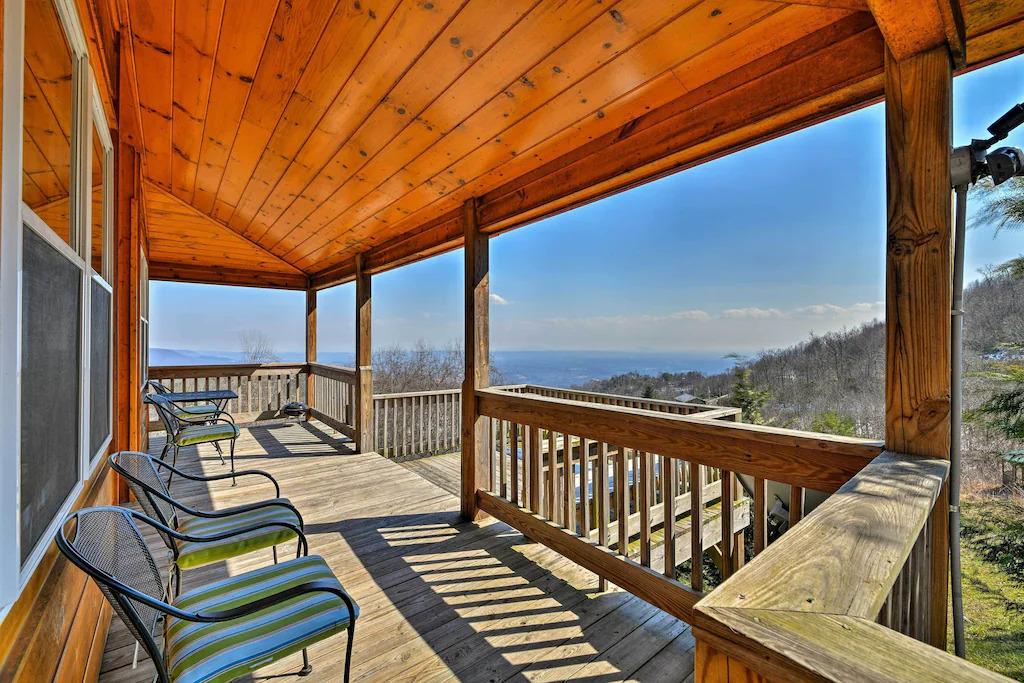 Phot of patio chairs on a deck overlooking a view of the Blue Ridge mountains