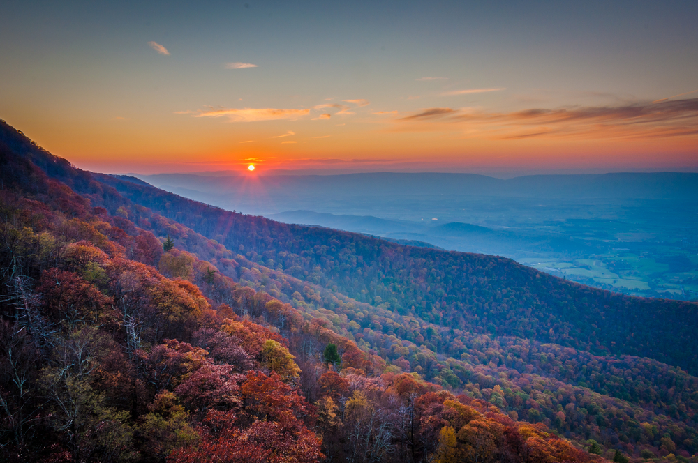 Vast autumn mountain view at sunset from Little Stony Man Overlook in Shenandoah National Forest, one of the best places to experience fall in Virginia.