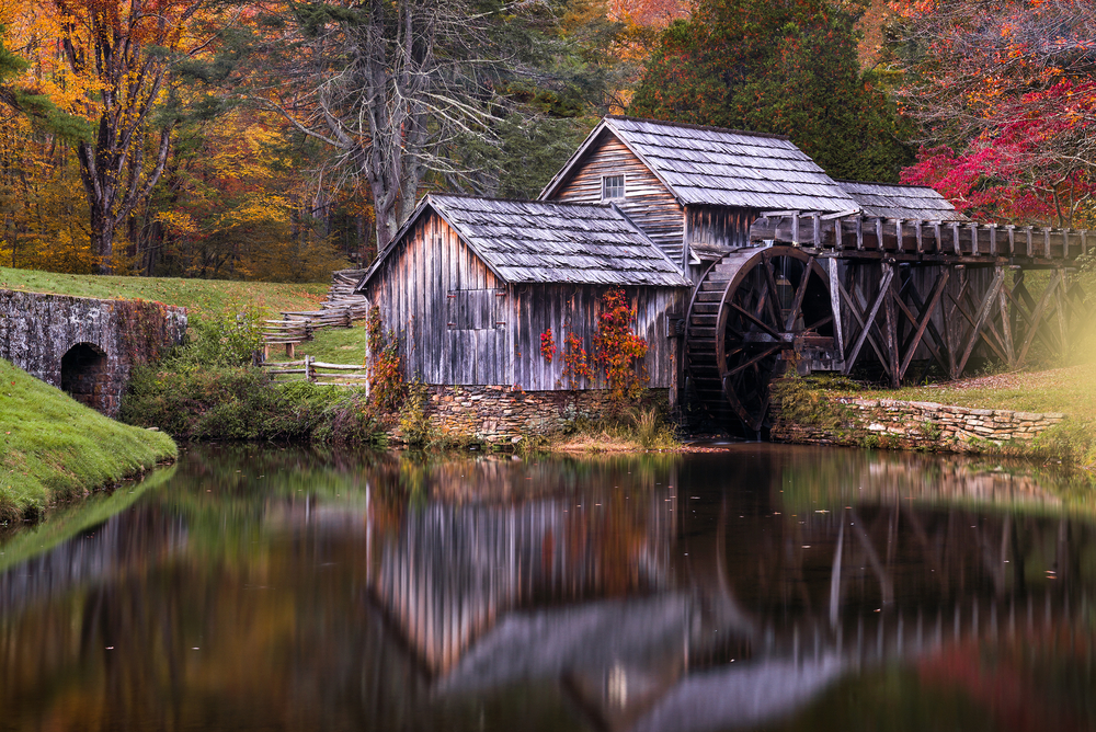 Mabry Mill with autumn foliage in the background, one of the best places to experience fall in Virginia.