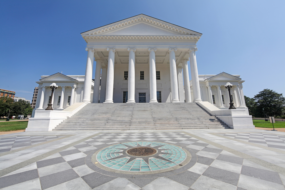 Photo of the Virginia State Capital with grand columns and a tall staircase leading up to it.