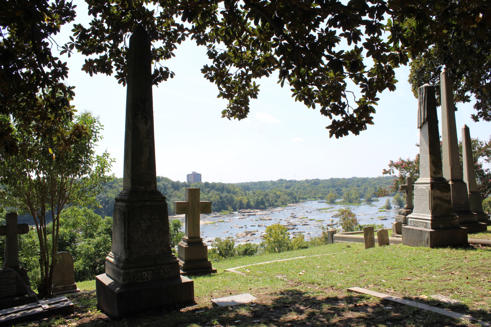 Photo of headstones overlooking the James River at Hollywood Cemetery in Richmond Virginia.