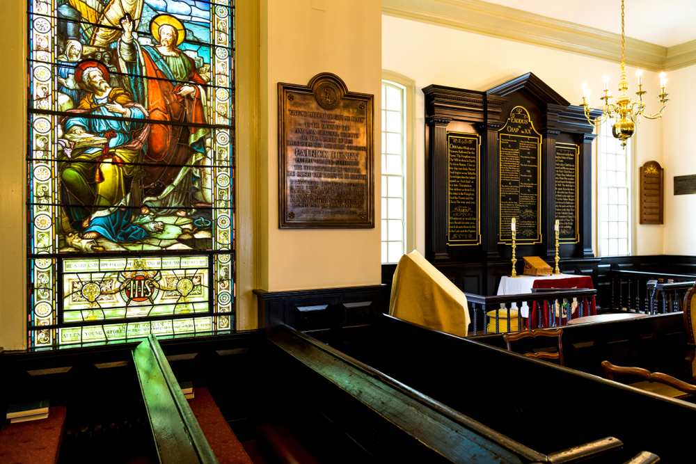 Photo of the inside of St. John's Church, one of the best things to do in Richmond, with stained glass and historic pews.