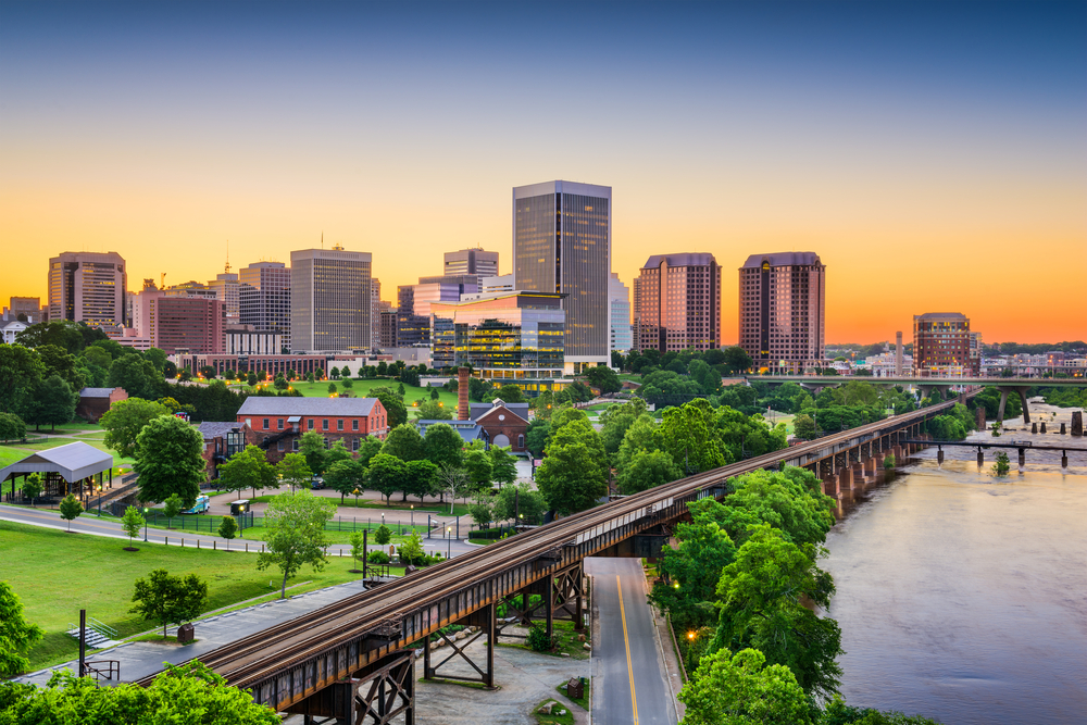 Photo of the Richmond Virginia skyline with the James River flowing nearby