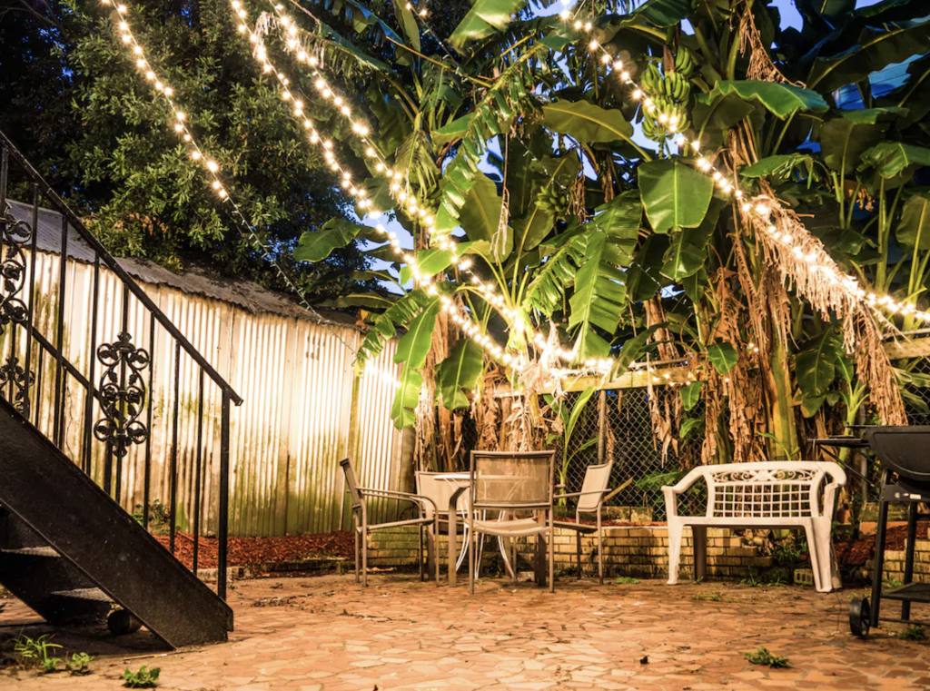 A delightful courtyard has a grill, perfect for nightcaps at one of the best airbnbs in New Orleans.