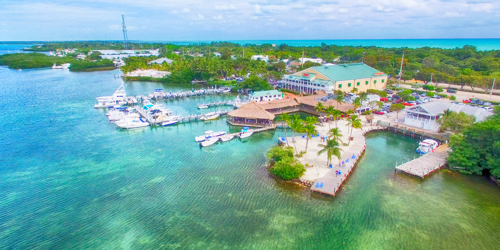 islamorada on a sunny day with crystal clear blue waters and boats