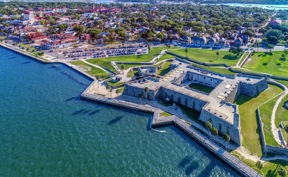 aerial photo of a fort on the waters edge