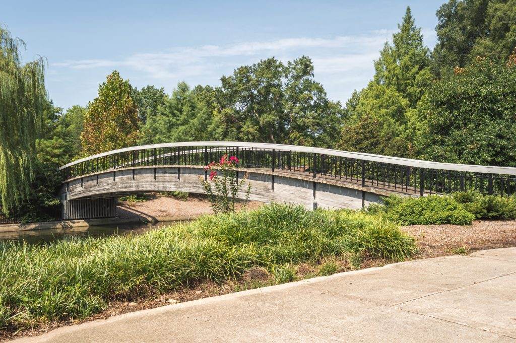 The oldest bridge, established in 1887, stands in Pullen Park, one of the best things to do in North Carolina