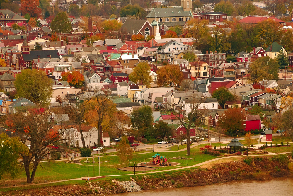 arial view of a town along the ohio river in kentucky. Many buildings of different colors and fall colors on the trees