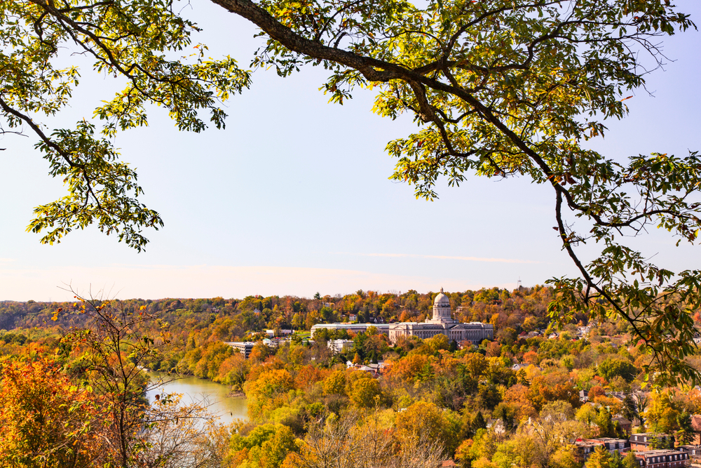 view over the city of frankfort, government buildings, river, and a lot of fall foliage