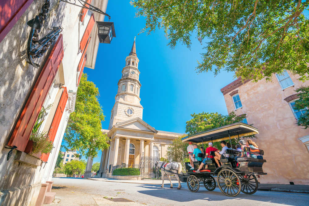 A horse drawn carriage tour as they make their way through Charleston's historic district