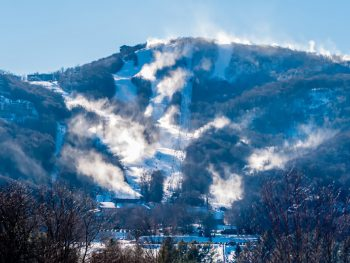 A photo of Sugar Mountain Ski Resort sitting at the bottom of the misty mountain.