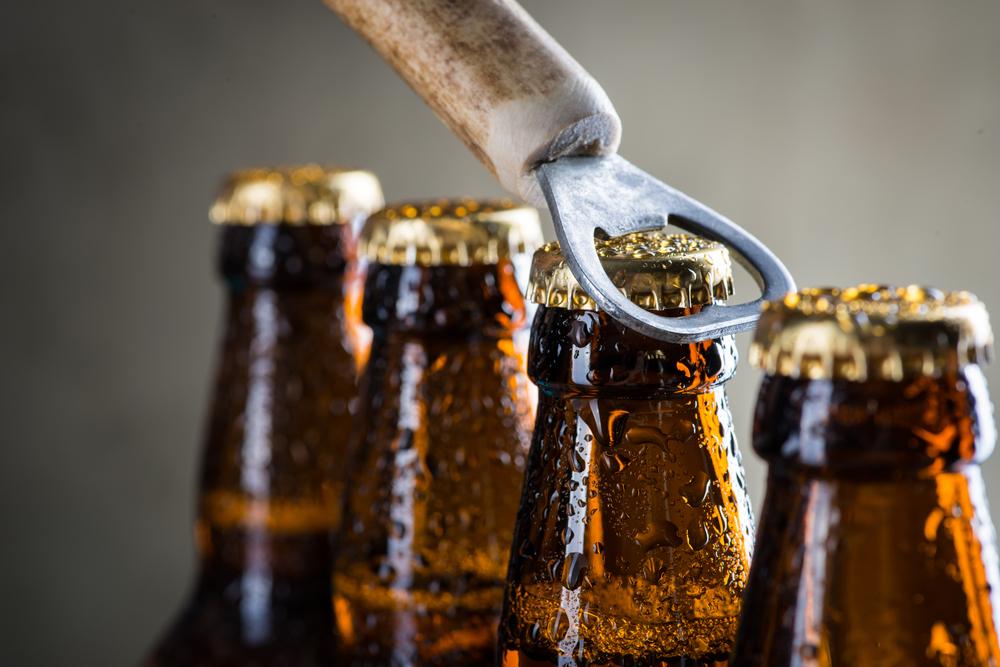 Four bottles of beer been opened