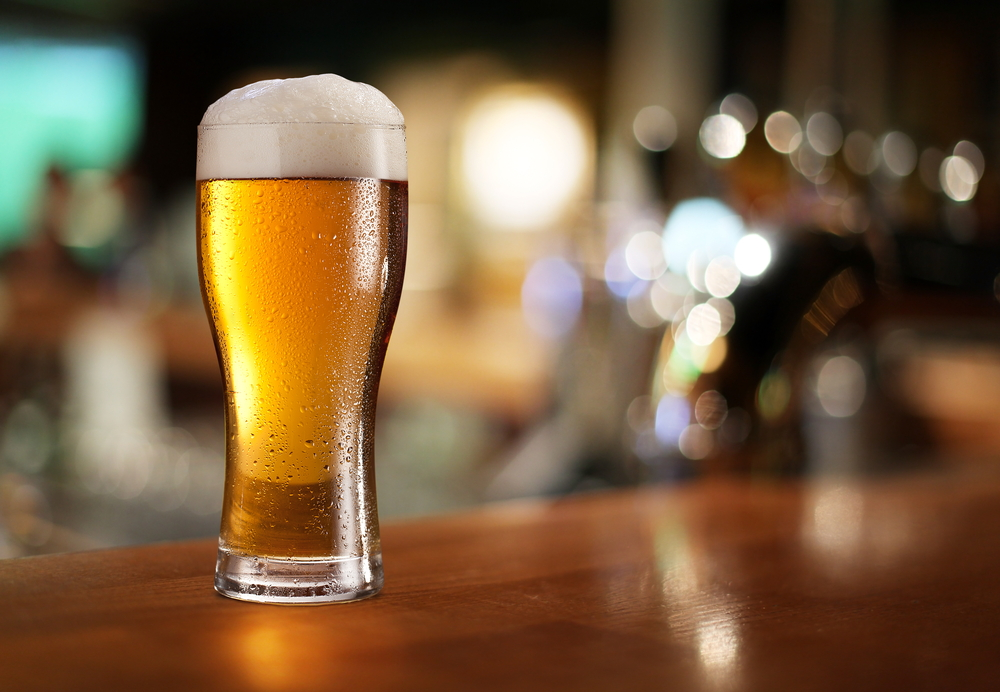 A pint of beer on the bar in an article about breweries in Asheville