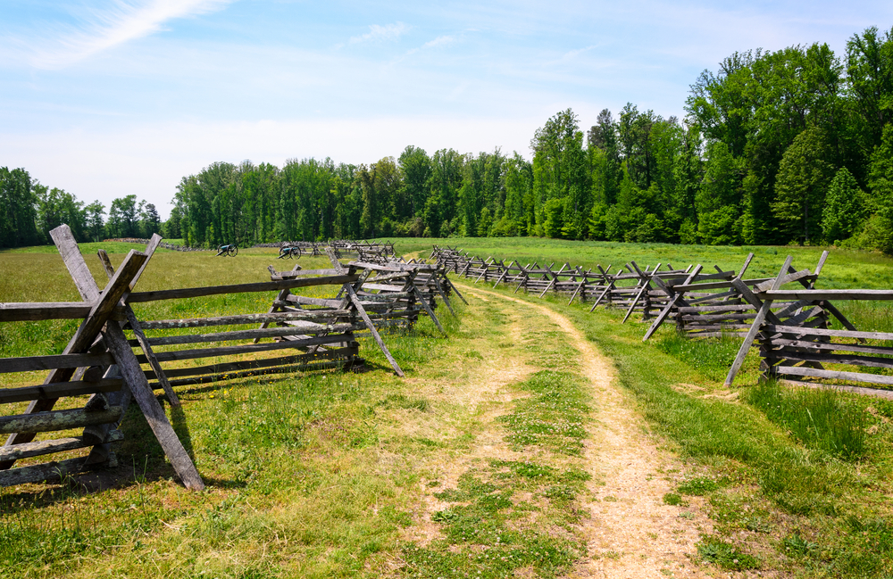 Fields with a path cutting through and bordered by a wooden fence at Richmond Battlefield