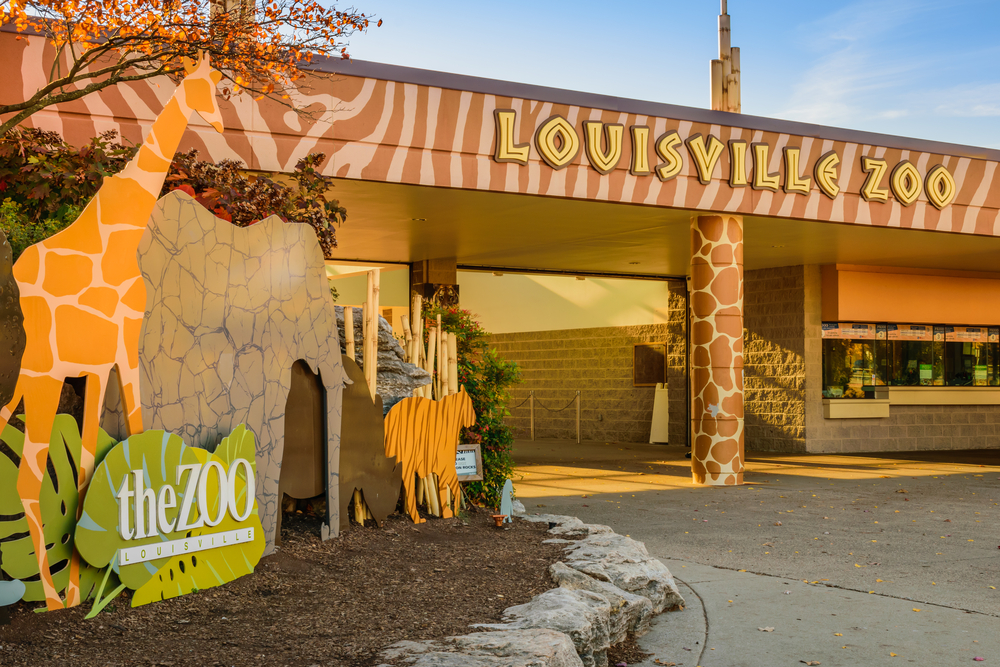 front of the louisville zoo with sign saying louisville zoo