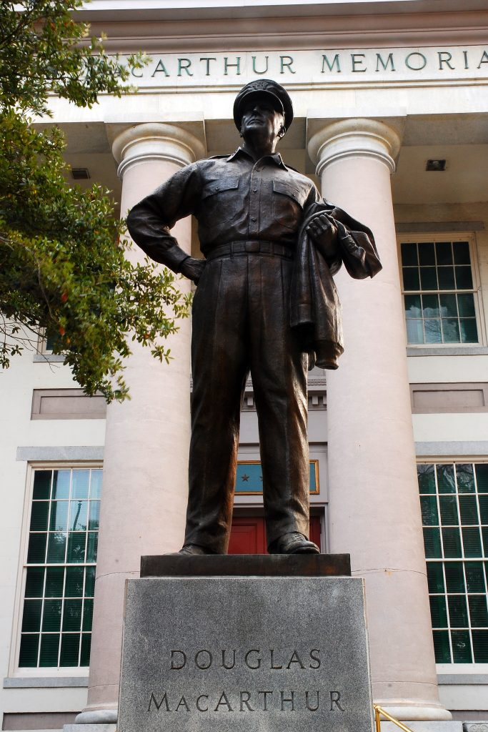 A robust statue of General Douglas MacArthur stands outside of his memorial, one of the best things to do in Norfolk VA