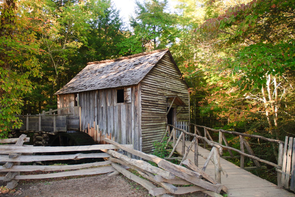 An old, wooden mill in Cade's Cove, one of the best things to do in the Smoky Mountains.