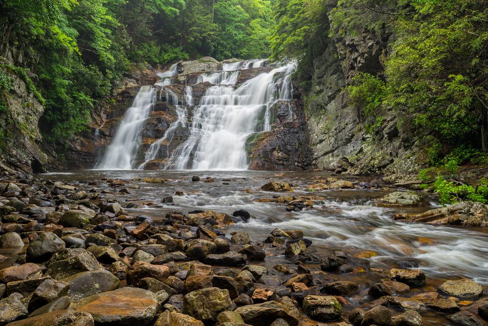 Laurel Falls cascading down a rock face into a river.