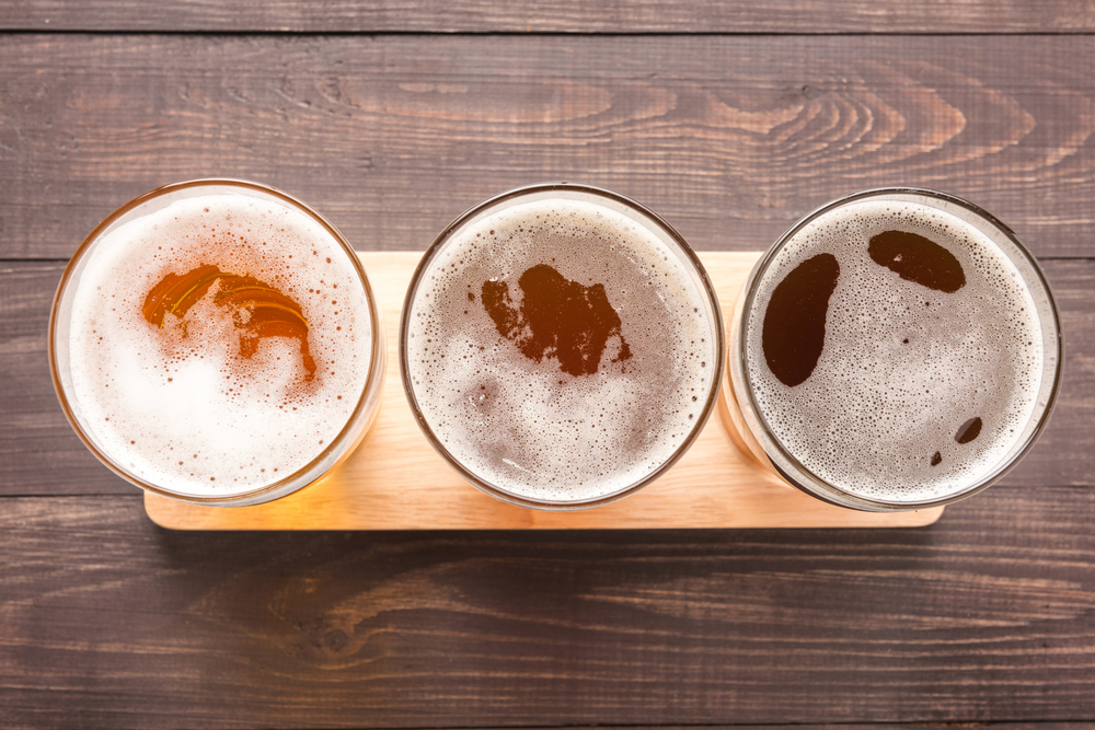 The foamy tops of a flight of craft beers.