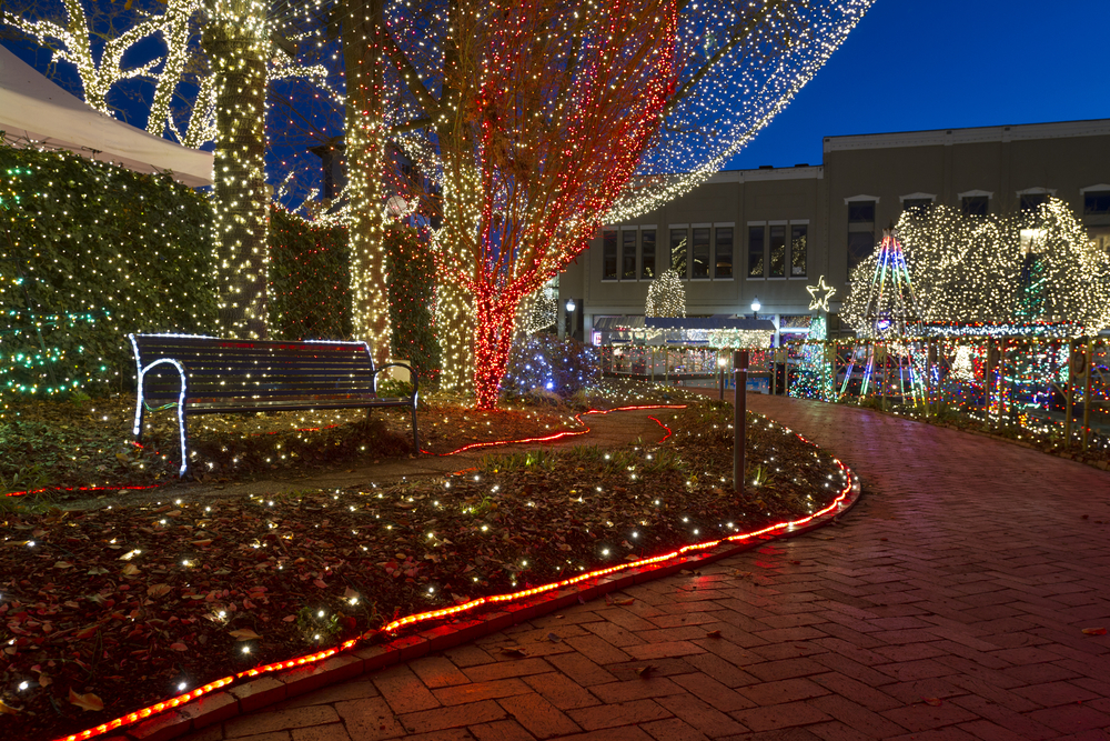 A brick path in a the city center in Fayetteville, Arkansas. All throughout the square in the city center there are thousands of different colored string lights covering every surface but the brick path. A great place to see lights for Christmas in the south.