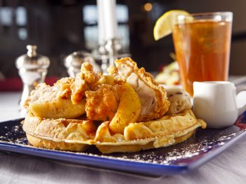 a chicken and waffle with sweet tea