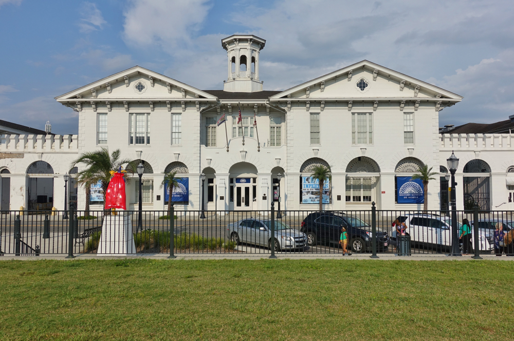 the white history museum of Mobile Alabama with a black fence and grassy area