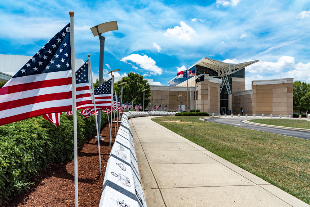 Photo of the US Army Airborne and Special Operations Museum with American flags outside, one of the best things to do in Fayetteville North Carolina