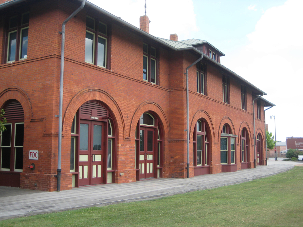 Photo of a historic red brick train station that houses the  Fayetteville Area Transportation Museum, one of the best things to do in Fayetteville NC