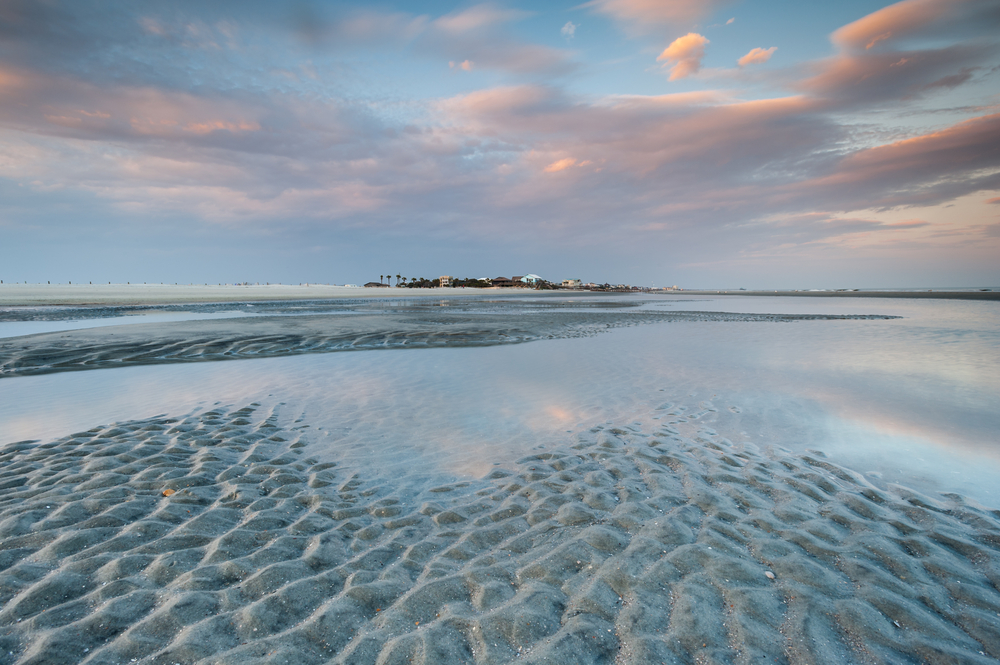 large sandy beach at sunrise, folly beach, one of the most popular beaches in charleston