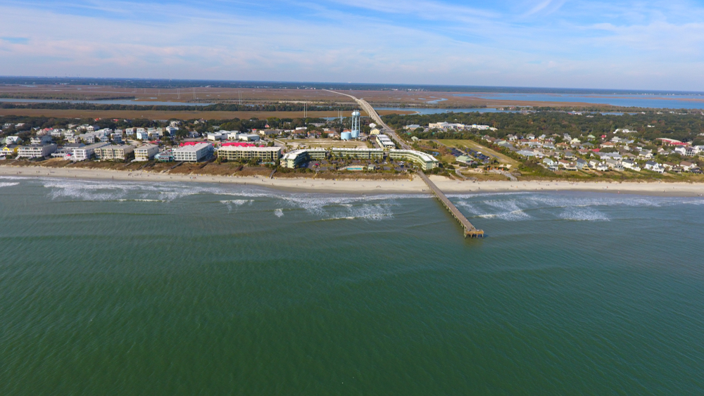 photo of ocean, pier, and beachfront buildings from above
