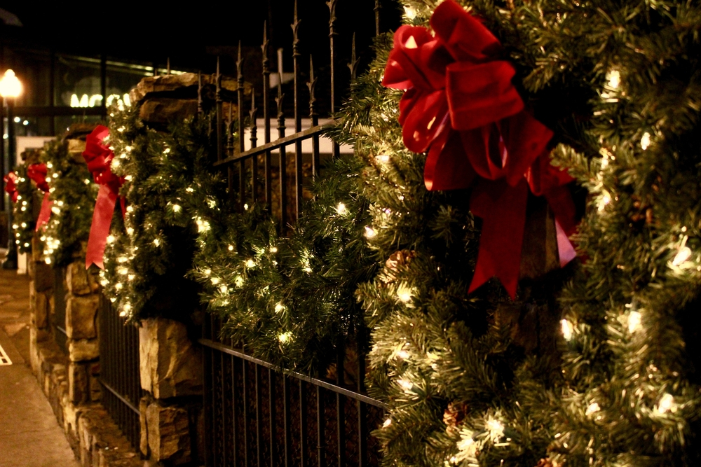 christmas wreaths and garlands with bows and christmas lights