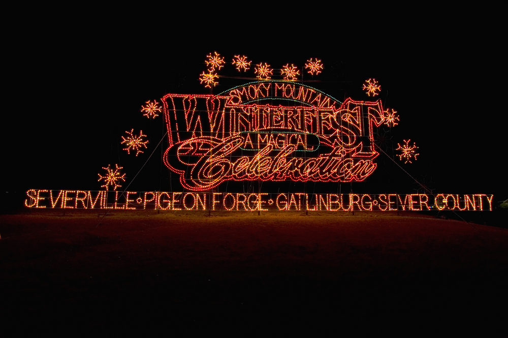 """a sign made of Christmas lights that says """"Winterfest"""""""