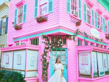 standing in front of pink building in georgetown DC